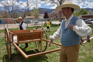 Mike shows off the Mormon handcart that he built using traditional woodworking techniques.