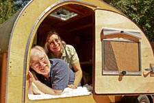 Jim & Barbara Cowlin in their teardrop trailer, the Pod